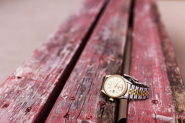 Wristwatch on picnic table - stress relief tips list and simple living resources