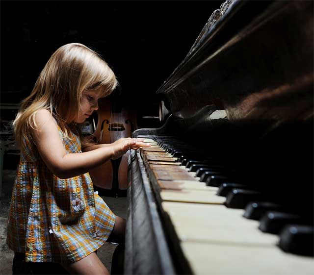 Girl Playing Piano - Unschooling and Self Worth