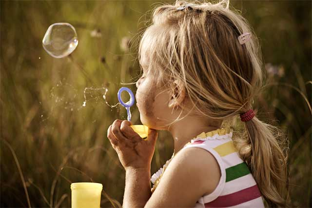 Girl Blowing Bubbles - Unschooling and self worth