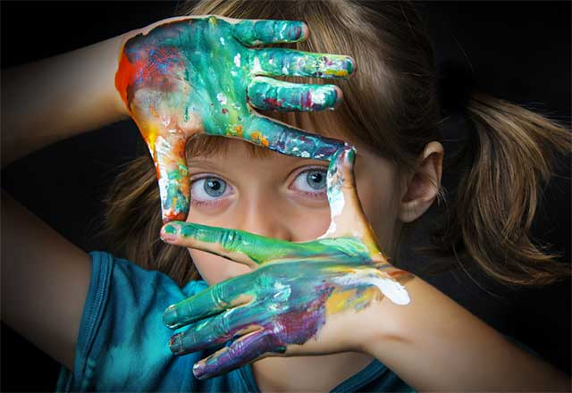 Girl with Painted Hands - Unschooling