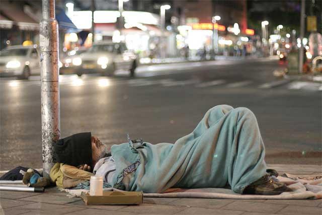 Homeless man sleeping - creating community interdependence