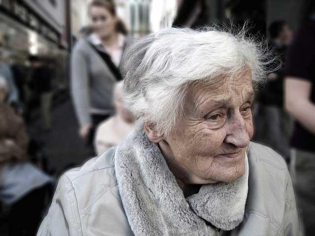 Elderly woman smiling - Creating Community